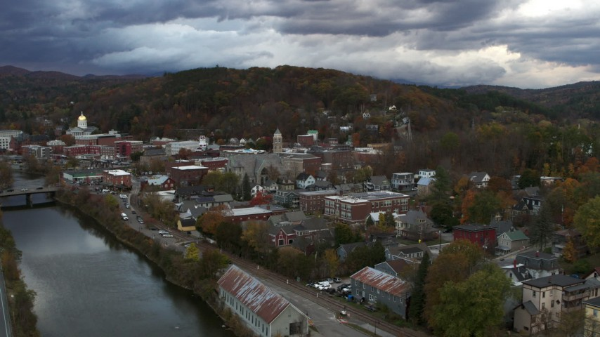5.7K stock footage aerial video of a wide orbit of city hall and brick buildings at sunset, approach from river, Montpelier, Vermont Aerial Stock Footage | DX0002_220_011