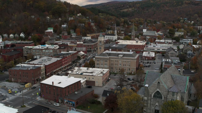 5.7K stock footage aerial video of a stationary view of city hall and brick buildings at sunset, Montpelier, Vermont Aerial Stock Footage | DX0002_220_013