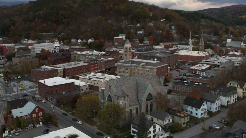 5.7K stock footage aerial video of circling city hall and flying away from brick buildings at sunset, Montpelier, Vermont Aerial Stock Footage | DX0002_220_014