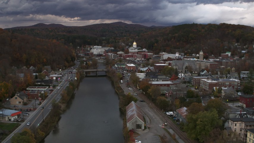 5.7K stock footage aerial video of flying by the river with a view of the state capitol at sunset, Montpelier, Vermont Aerial Stock Footage | DX0002_220_016