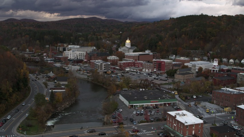 5.7K stock footage aerial video of a stationary and reverse view of the state capitol at sunset from the river, Montpelier, Vermont Aerial Stock Footage | DX0002_220_019