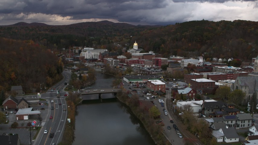 5.7K stock footage aerial video of the state capitol at sunset seen from a bridge on the river, Montpelier, Vermont Aerial Stock Footage | DX0002_220_020
