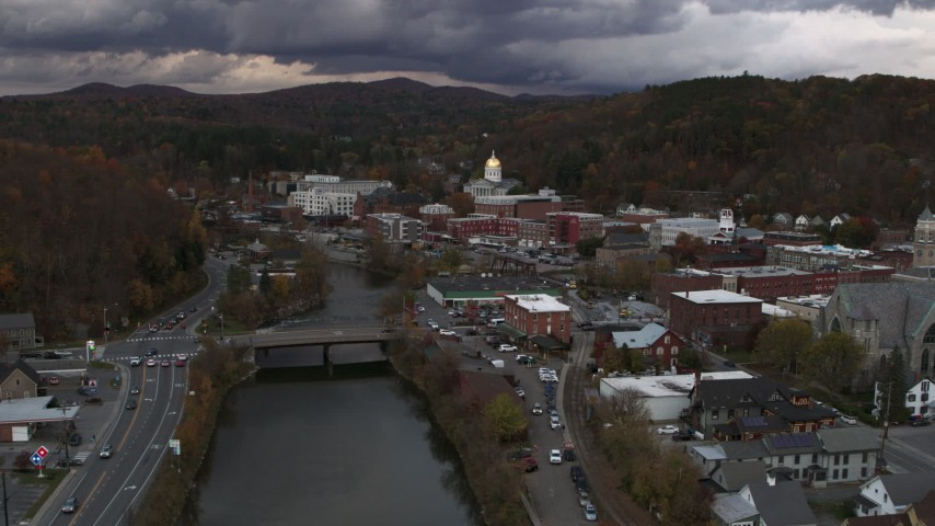 5.7K stock footage aerial video of the state capitol at sunset while following the river, Montpelier, Vermont Aerial Stock Footage | DX0002_220_022