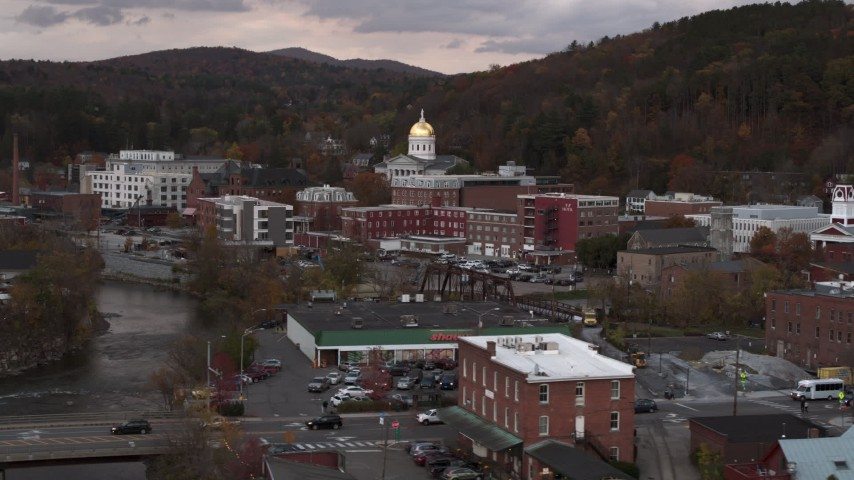 5.7K stock footage aerial video the capitol dome at sunset seen from a bridge over the river, Montpelier, Vermont Aerial Stock Footage | DX0002_220_024