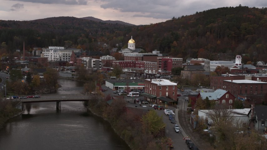 5.7K stock footage aerial video ascend over a bridge while focused on the capitol dome at sunset, Montpelier, Vermont Aerial Stock Footage | DX0002_220_027