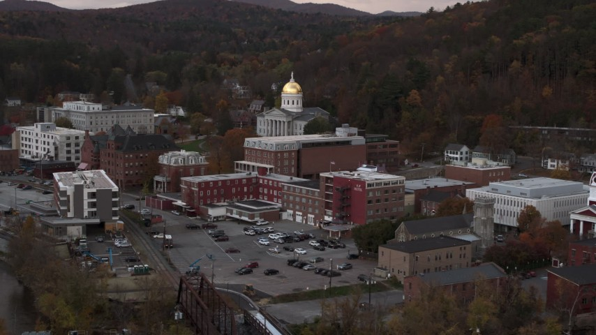 5.7K stock footage aerial video circling and fly away from the capitol dome at sunset, Montpelier, Vermont Aerial Stock Footage | DX0002_220_028