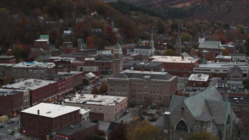 5.7K stock footage aerial video of flying by city hall at sunset, reveal church, Montpelier, Vermont Aerial Stock Footage | DX0002_220_032