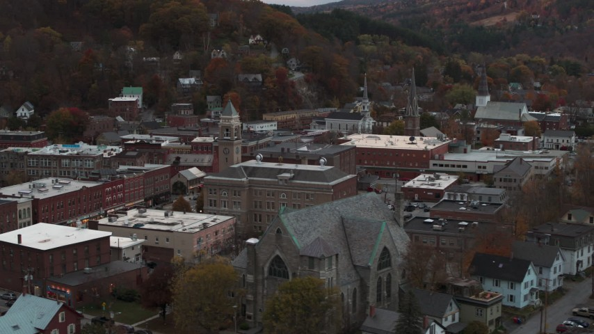 5.7K stock footage aerial video of passing by a church and city hall at sunset, Montpelier, Vermont Aerial Stock Footage | DX0002_220_033