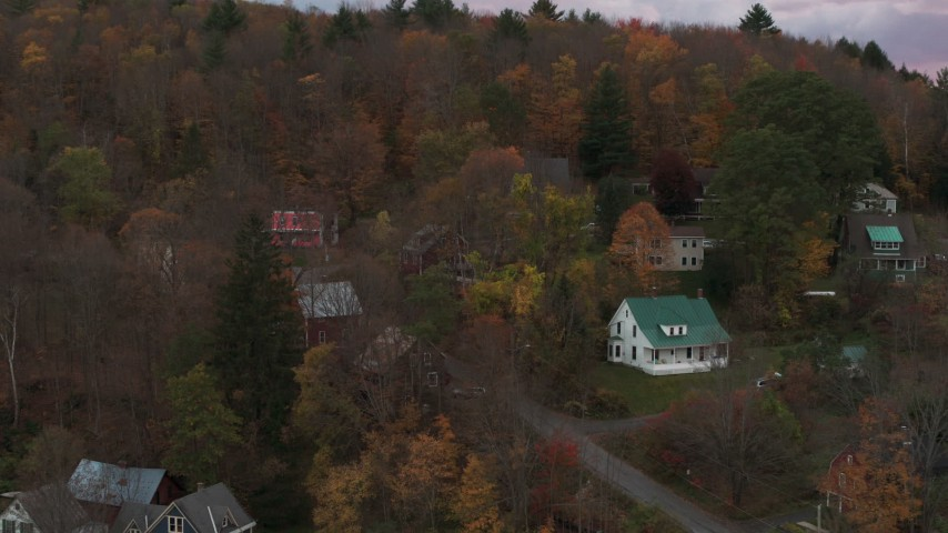 5.7K stock footage aerial video of circling homes on a hill at sunset, Montpelier, Vermont Aerial Stock Footage | DX0002_220_040