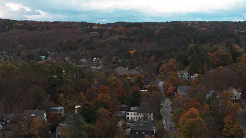 5.7K stock footage aerial video of an orbit of homes on a hill with colorful trees at sunset, Montpelier, Vermont Aerial Stock Footage | DX0002_220_041