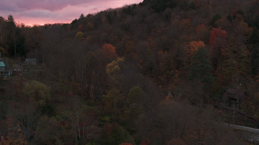 5.7K stock footage aerial video of orbiting and flying away from hills with colorful trees at sunset, Montpelier, Vermont Aerial Stock Footage | DX0002_220_043