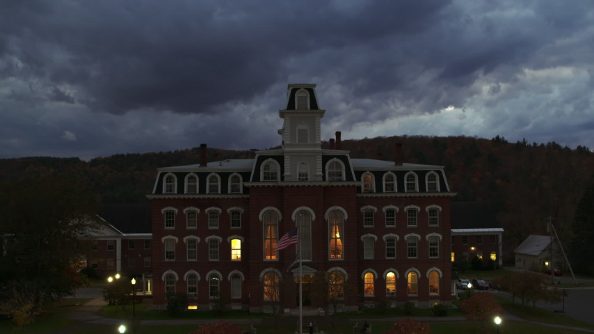 5.7K stock footage aerial video focus on the Vermont College of Fine Arts while ascending at twilight, Montpelier, Vermont Aerial Stock Footage   DX0002_220_049