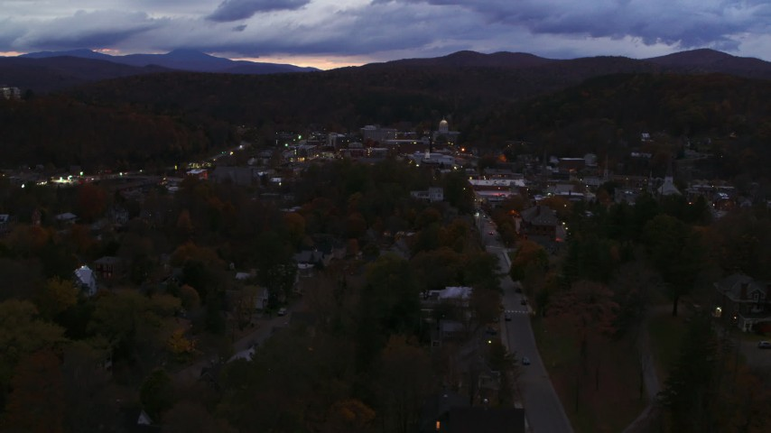 5.7K stock footage aerial video of the downtown area of the city seen while passing State Street at twilight, Montpelier, Vermont Aerial Stock Footage | DX0002_220_055