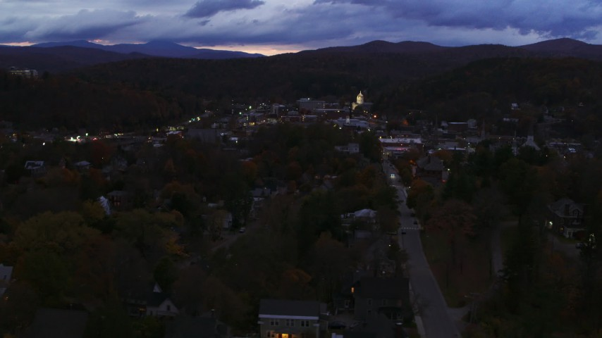 5.7K stock footage aerial video of the downtown area of the city seen while flying by State Street at twilight, Montpelier, Vermont Aerial Stock Footage | DX0002_220_056