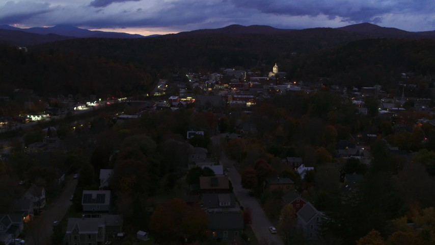 5.7K stock footage aerial video of the downtown area of the city seen from homes and State Street at twilight, Montpelier, Vermont Aerial Stock Footage | DX0002_220_057