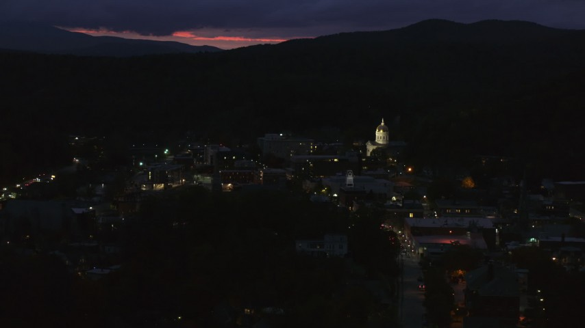 5.7K stock footage aerial video of city buildings around the capitol dome lit up at twilight, Montpelier, Vermont Aerial Stock Footage | DX0002_220_064