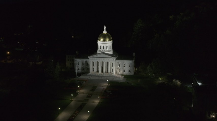 5.7K stock footage aerial video of a reverse view of the Vermont State Capitol at night, Montpelier, Vermont Aerial Stock Footage | DX0002_221_004