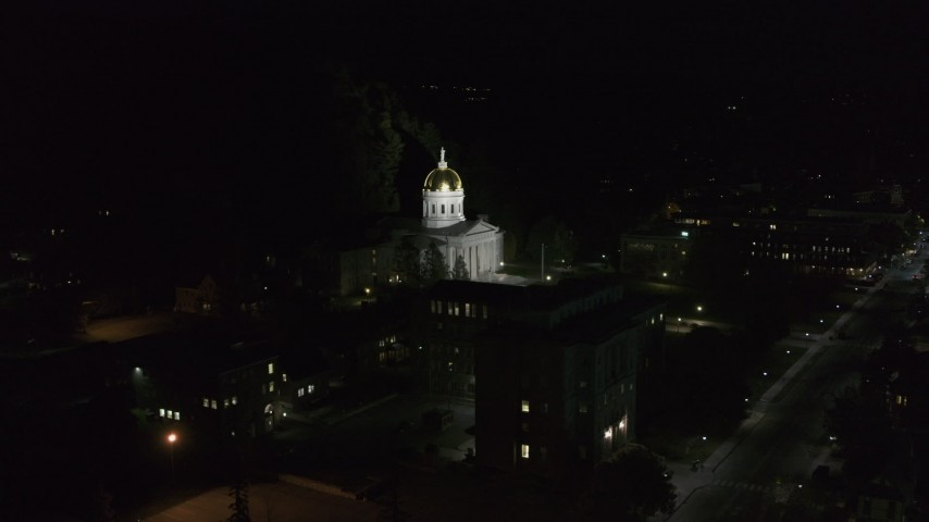 5.7K stock footage aerial video of approaching and orbiting the front of the Vermont State Capitol at night, Montpelier, Vermont Aerial Stock Footage | DX0002_221_007
