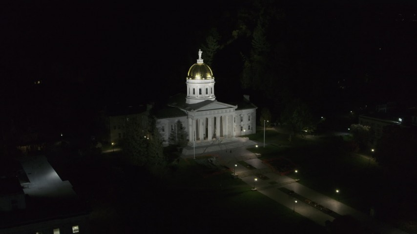 5.7K stock footage aerial video of closely orbiting the front of the Vermont State Capitol at night, Montpelier, Vermont Aerial Stock Footage | DX0002_221_008