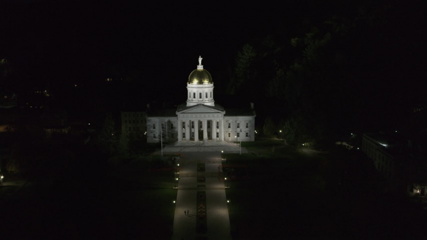 5.7K stock footage aerial video of flying toward the front of the Vermont State Capitol at night, Montpelier, Vermont Aerial Stock Footage | DX0002_221_009