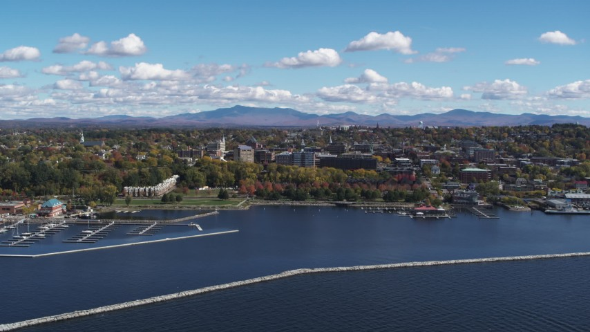 5.7K stock footage aerial video of the downtown area seen from Lake Champlain breakwaters, Burlington, Vermont Aerial Stock Footage | DX0002_222_007