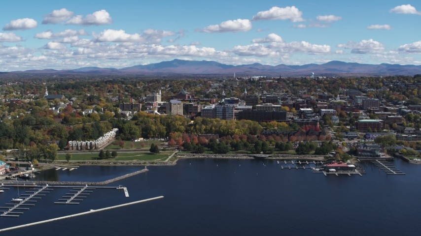 5.7K stock footage aerial video of the downtown area seen from Lake Champlain breakwaters, Burlington, Vermont Aerial Stock Footage | DX0002_222_008