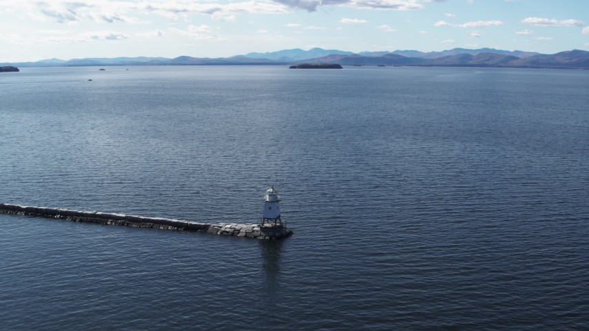 5.7K stock footage aerial video descend and orbit a lighthouse on Lake Champlain, Burlington, Vermont Aerial Stock Footage | DX0002_222_010