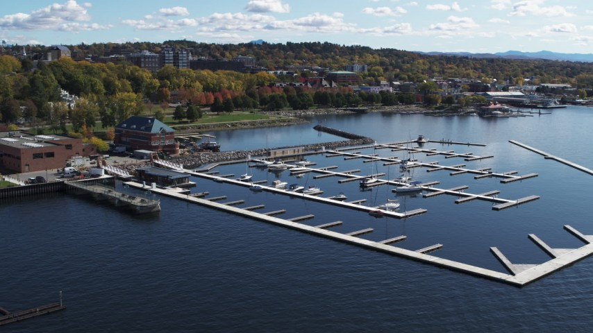 5.7K stock footage aerial video fly away from and orbit a marina on Lake Champlain, Burlington, Vermont Aerial Stock Footage | DX0002_222_014