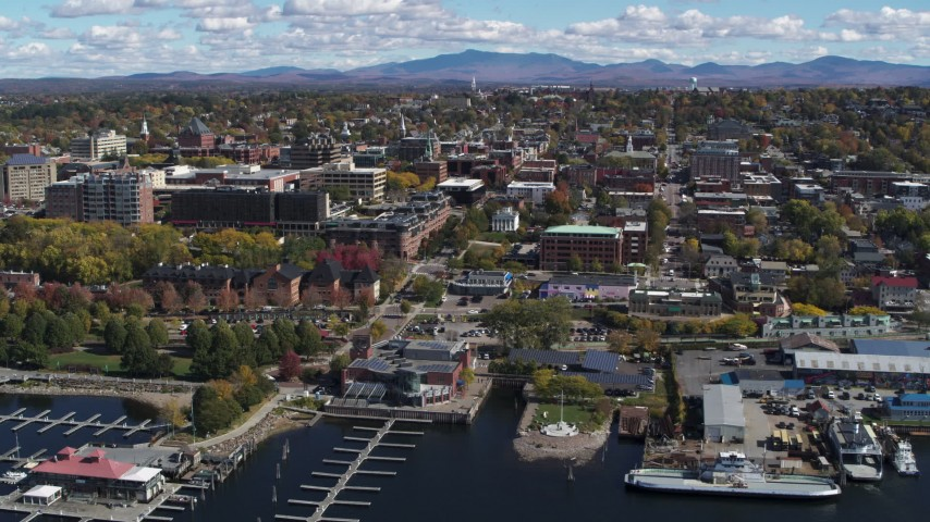 5.7K stock footage aerial video of circling downtown, seen from Lake Champlain, Burlington, Vermont Aerial Stock Footage | DX0002_222_016