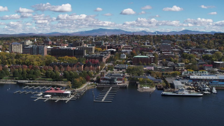 5.7K stock footage aerial video of a slow orbit of downtown, seen from Lake Champlain, Burlington, Vermont Aerial Stock Footage | DX0002_222_017