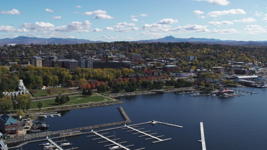 5.7K stock footage aerial video fly away from downtown, reveal marina on Lake Champlain, Burlington, Vermont Aerial Stock Footage | DX0002_222_019