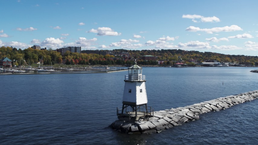 5.7K stock footage aerial video approach and ascend over a lighthouse on Lake Champlain toward downtown, Burlington, Vermont Aerial Stock Footage | DX0002_222_022