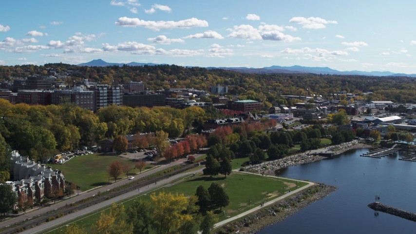 5.7K stock footage aerial video of a view of downtown, seen while descending by a lakefront park, Burlington, Vermont Aerial Stock Footage | DX0002_222_025