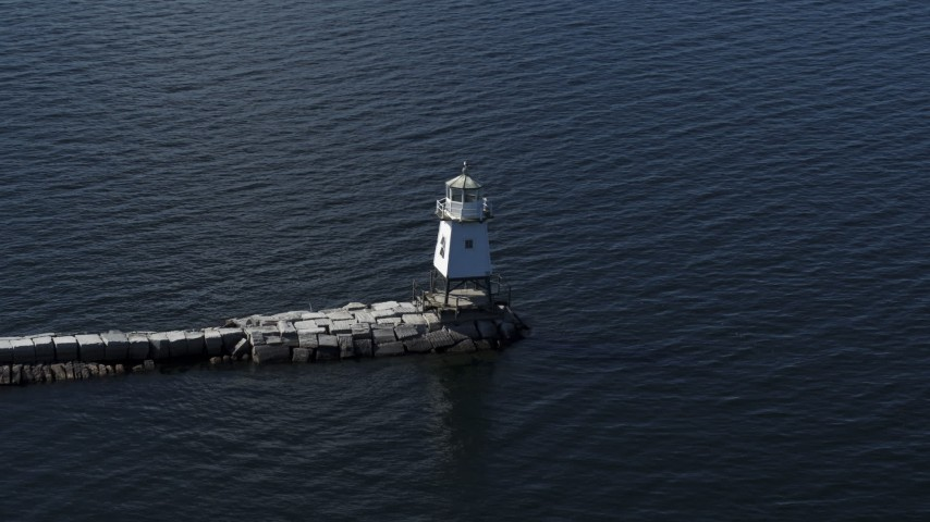 5.7K stock footage aerial video of ascending around a lighthouse on Lake Champlain, Burlington, Vermont Aerial Stock Footage | DX0002_222_029