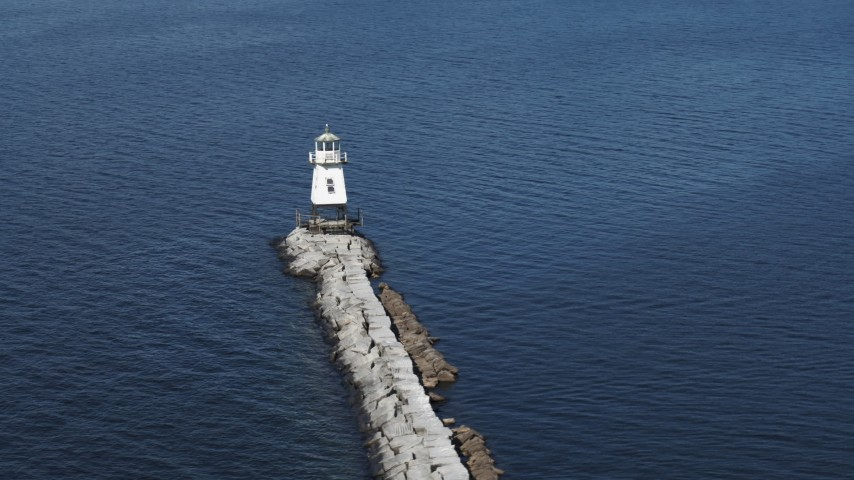 5.7K stock footage aerial video circling a lighthouse at the end of a breakwater on Lake Champlain, Burlington, Vermont Aerial Stock Footage | DX0002_222_030