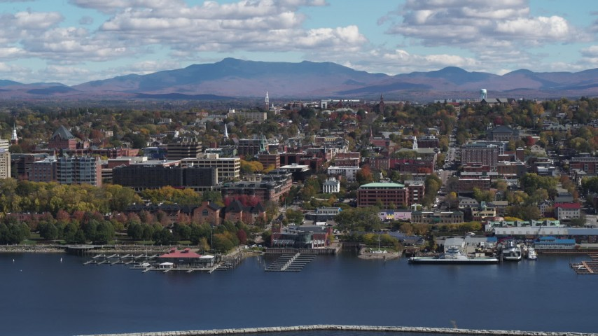 5.7K stock footage aerial video of a stationary view of city buildings in downtown, seen from the lake, Burlington, Vermont Aerial Stock Footage | DX0002_222_039