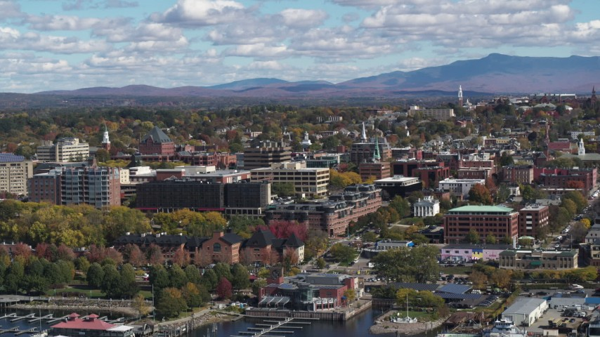 5.7K stock footage aerial video slowly approach and flyby city buildings in downtown, seen from the lake, Burlington, Vermont Aerial Stock Footage | DX0002_222_040