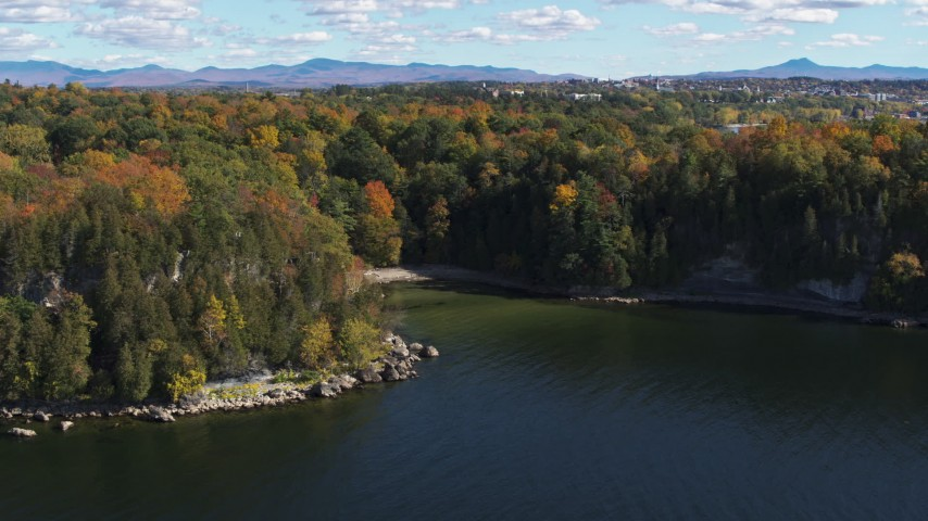 5.7K stock footage aerial video of orbiting a small cove in Lake Champlain, Burlington, Vermont Aerial Stock Footage | DX0002_223_005