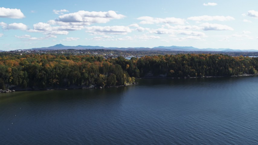 5.7K stock footage aerial video of a reverse view of forest on the shore of Lake Champlain, Burlington, Vermont Aerial Stock Footage | DX0002_223_006