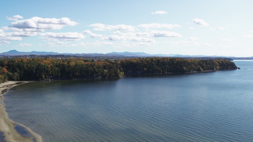 5.7K stock footage aerial video of a reverse view of forest on Lone Rock Point by Lake Champlain, and descend, Burlington, Vermont Aerial Stock Footage | DX0002_223_007