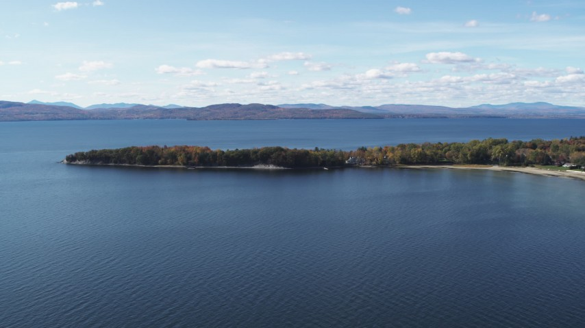 5.7K stock footage aerial video of a view of a few waterfront homes on Appletree Point by Lake Champlain, Burlington, Vermont Aerial Stock Footage | DX0002_223_010