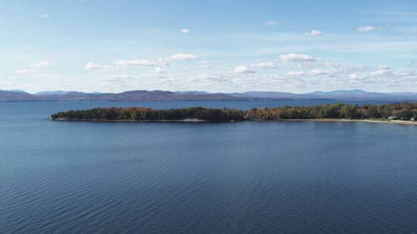 5.7K stock footage aerial video of flying by a few waterfront homes on Appletree Point by Lake Champlain, Burlington, Vermont Aerial Stock Footage | DX0002_223_012