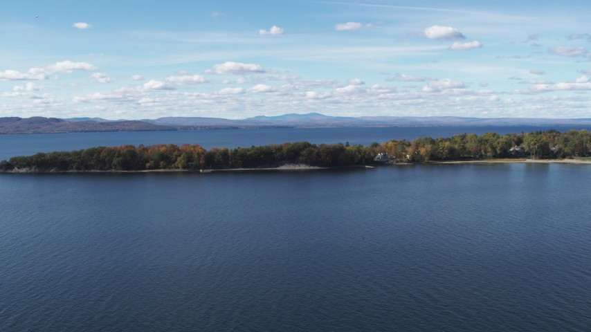 5.7K stock footage aerial video of passing by lakefront homes on Appletree Point by Lake Champlain, Burlington, Vermont Aerial Stock Footage | DX0002_223_014