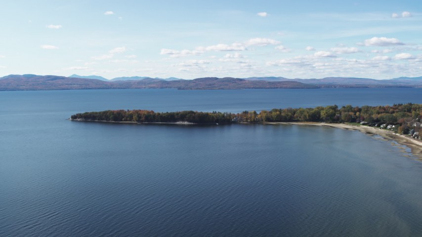 5.7K stock footage aerial video of flying by lakefront homes on Appletree Point by Lake Champlain, Burlington, Vermont Aerial Stock Footage | DX0002_223_015