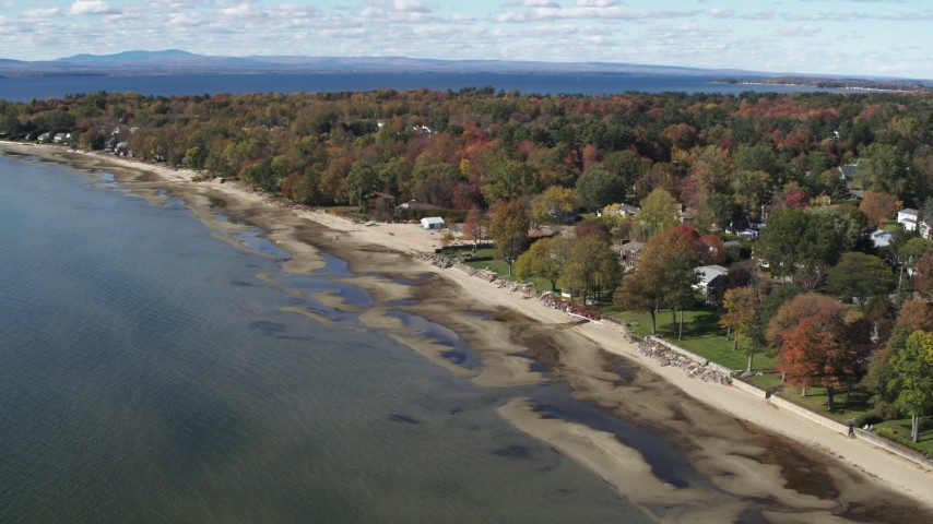 5.7K stock footage aerial video of orbiting beachfront homes on the shore of Lake Champlain, Burlington, Vermont Aerial Stock Footage | DX0002_223_016