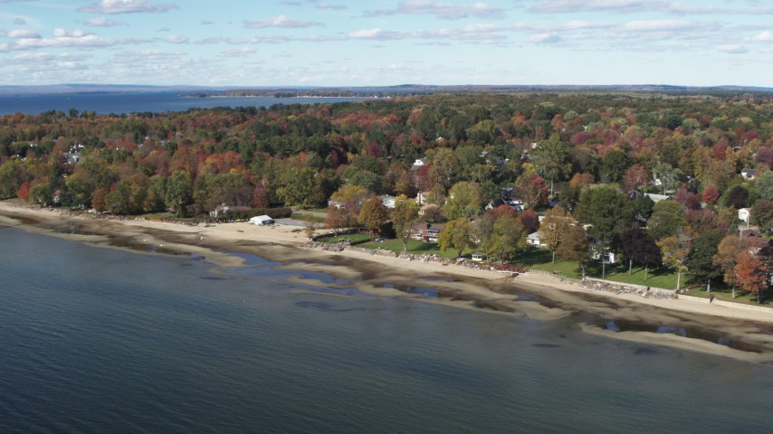 5.7K stock footage aerial video of an orbit of beachfront homes on the shore of Lake Champlain, Burlington, Vermont Aerial Stock Footage | DX0002_223_019