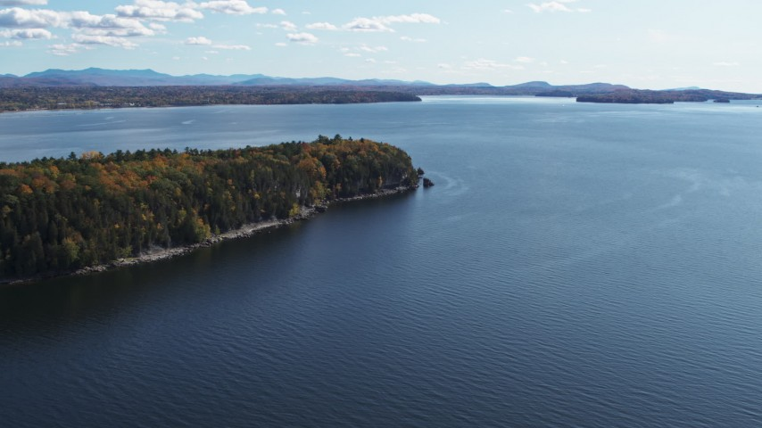 5.7K stock footage aerial video of approaching forest on Lone Rock Point by Lake Champlain, Burlington, Vermont Aerial Stock Footage | DX0002_223_021