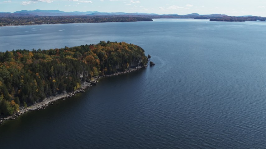 5.7K stock footage aerial video of approaching forest on the tip of Lone Rock Point by Lake Champlain, Burlington, Vermont Aerial Stock Footage | DX0002_223_022