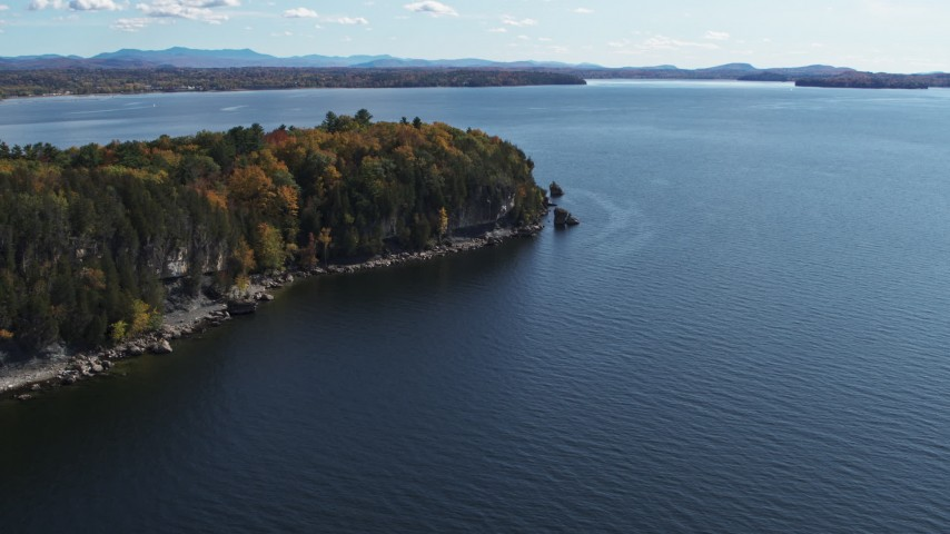 5.7K stock footage aerial video of forest on the tip of Lone Rock Point by Lake Champlain, Burlington, Vermont Aerial Stock Footage | DX0002_223_023