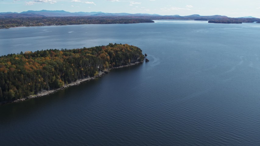 5.7K stock footage aerial video of a reverse view of forest on the tip of Lone Rock Point by Lake Champlain, Burlington, Vermont Aerial Stock Footage | DX0002_223_025